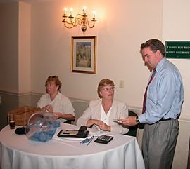 Dawn Breza, Rita Hausnan, and Jerry Fennelly puchasing what would later be a Grand Prize winning ticket.